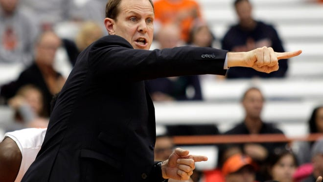 Syracuse assistant coach Mike Hopkins signals to players during the second half of an exhibition game last season. Hopkins has been on the SU staff since 1995.