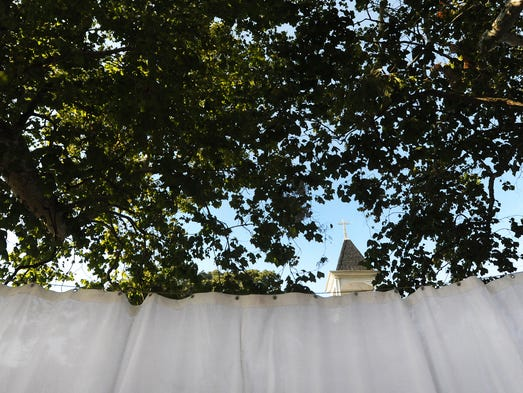 The curtain is hung between two trees at St. George's