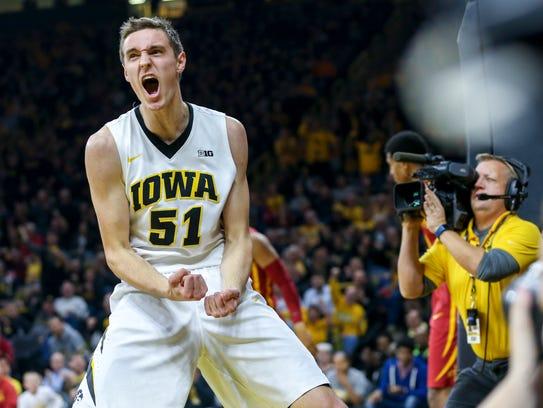 Iowa forward Nicholas Baer lets out a scream after