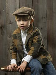 Austin Hester, age 4, in clothes his mother bought him in Ireland. Austin wore a hat for his first three years in America.
