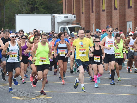 Runners begin the half-marathon race of the 2016 Dutchess
