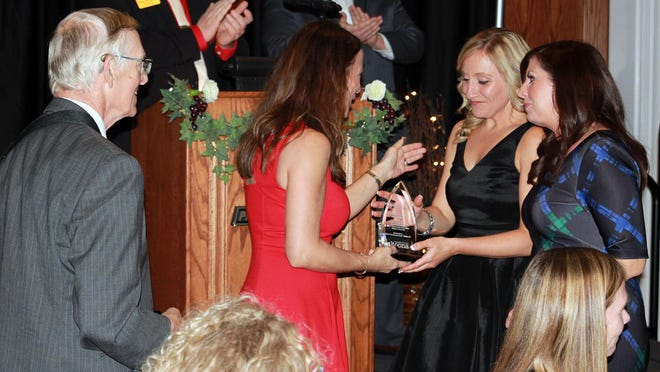 Kerrin Martinson and Maggie Crabb were surprised to receive the Outstanding Citizens Award at the Altoona Chamber Dinner.