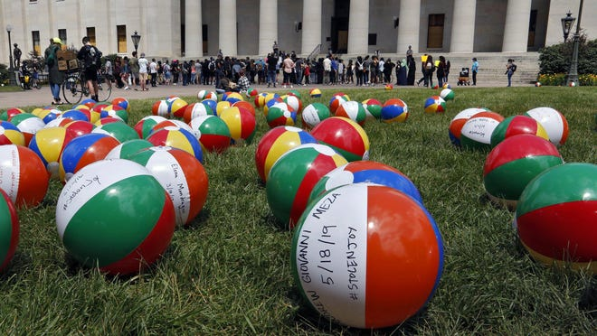 Hundreds of beach balls placed on the Statehouse lawn during Saturday's demonstration are part of the #stolenjoy project, with each ball representing a person younger than 21 who died in an interaction with police.