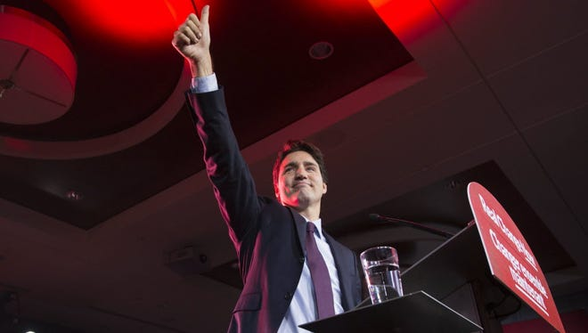 Justin Trudeau, Canada's new leader, gestures on stage at the Liberal party headquarters in Montreal, on Oct. 20.