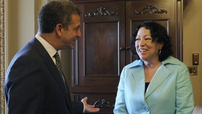Then-U.S. Sen. Russ Feingold, D-Wisconsin, talks with Sonya Sotomayor after her nomination to the U.S. Supreme Court in this 2009 photo.