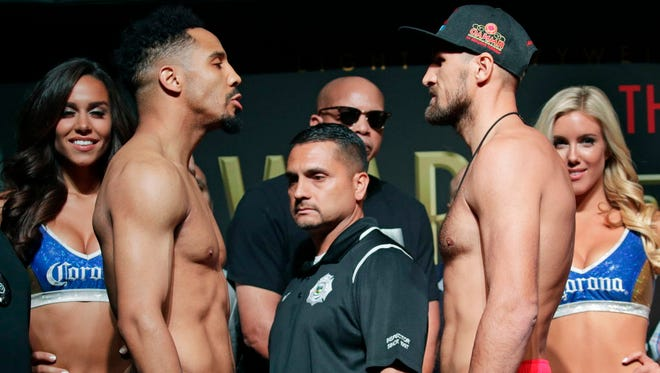 Andre Ward (left) and Sergey Kovalev pose for photographers during a weigh-in Friday in Las Vegas. The two are scheduled to fight in a light heavyweight championship boxing match Saturday in Las Vegas.