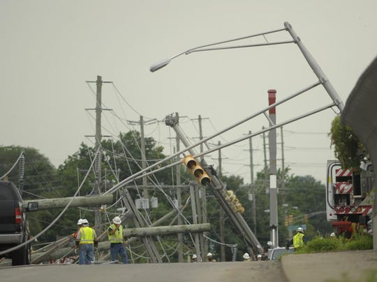 The storm left a twisted mess for utility crews in Greenwich, where a quarter of the town remained without power Sunday.