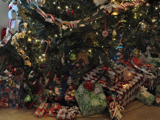 Presents are still piled high beneath the Schneider family's Christmas tree, which will remain up through Epiphany on Wednesday. For the Alexandria family, Dec. 25 marks only the beginning of the Christmas season.