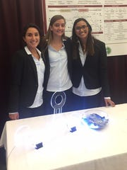 "Florida Tech students (from left) Marina DeBiasi, Sarah Torkaman and Martha Perez won ""best in show"" at the 2018 Northrop Grumman Engineering & Science Senior Design Showcase."