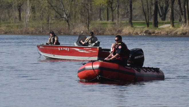 St. Cloud fire and Stearns county officers search the Mississippi River Monday, May 7.