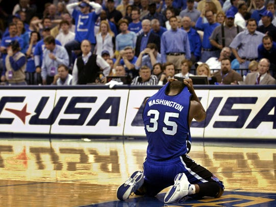 Memphis freshman Darius Washington crumbles to the ground after missing two of three foul shots with no time on the clock, giving Louisville the 75-74 victory in the 2005 Conference USA championship game.