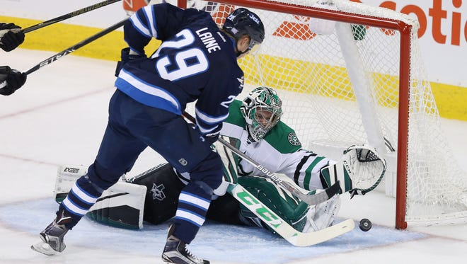 Jets forward Patrik Laine (29) puts the puck past Stars goalie Kari Lehtonen (32) for his second goal of the game.