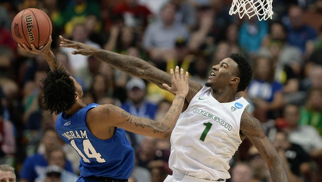 March 24, 2016; Anaheim, CA, USA; Oregon Ducks forward Jordan Bell (1) defends against Duke Blue Devils guard Brandon Ingram (14) during the second half of the semifinal game in the West regional of the NCAA Tournament at Honda Center. Mandatory Credit: Robert Hanashiro USA TODAY Sports