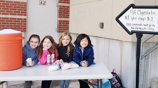 Ranch Heights students Anna Eidson, Peyton Solenberger, Lily Pendergraff and Emily Liu sell hot cocoa to raise money for the Washington County SPCA. Not pictured is Abbriella Flores. Courtesy