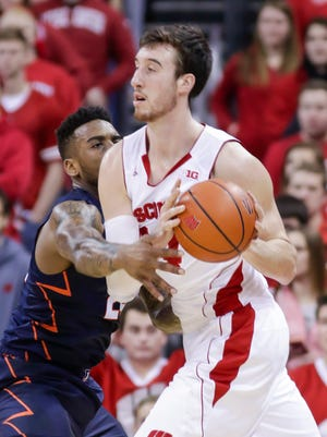 Illinois' Rayvonte Rice, left, reaches in on Wisconsin's Frank Kaminsky during the first half of Sunday's Big Ten men's basketball game at the Kohl Center in Madison.
