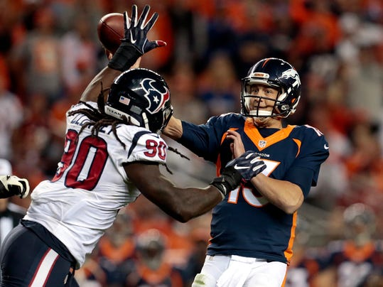 FILE - In this Oct. 24, 2016, file photo, Denver Broncos quarterback Trevor Siemian (13) throws under pressure from Houston Texans defensive end Jadeveon Clowney (90) during the second half of an NFL football game, in Denver. For as many similarities as there are between Jadeveon Clowney and Khalil Mack as the two edge defenders taken in the top five of the 2014 draft, there are the stark differences as well. (AP Photo/Joe Mahoney, File)