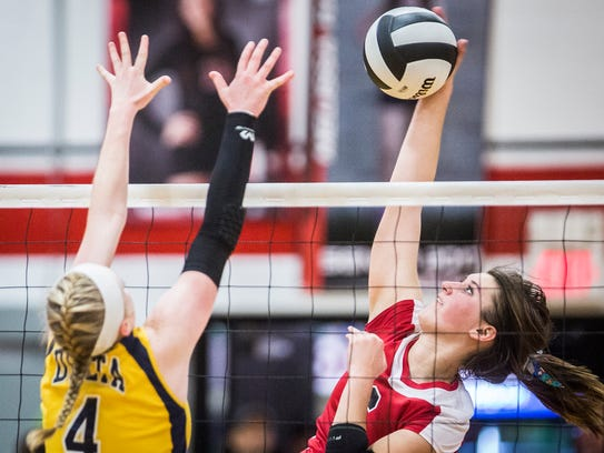 Wapahani sends the ball over the net in a match against