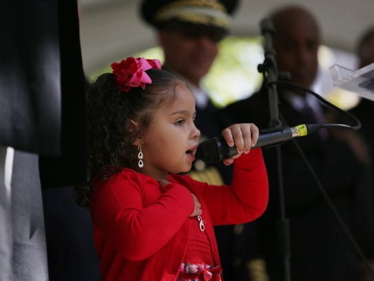 Jayla Nicole Parish, 3 leads the Pledge of Allegiance