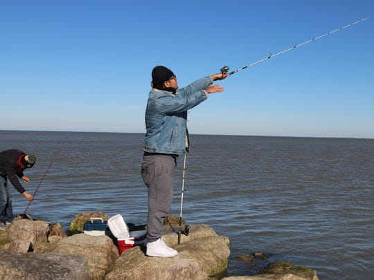 Zicheng Zhao, of Cincinnati, reeled in a few yellow perch after making the trip to Port Clinton on an unseasonably warm day in late November.