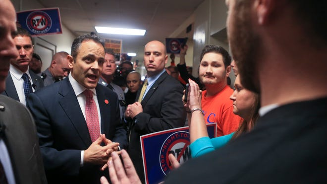 Gov. Matt Bevin talks to union members about his reason for supporting Right-To-Work legislation in the Capitol Annex Wednesday. Bevin testified for the Republicans Right-To-Work legislation.