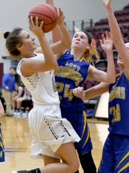 Siloam Springs guard Chloe Price goes up for a shot