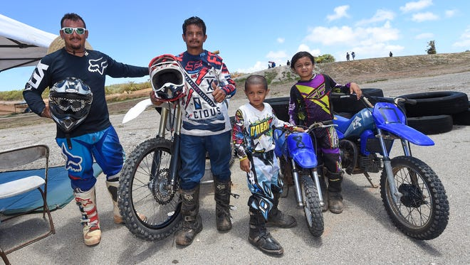 A motocross family poses for a group photo during the Monster Energy 2016 Guam Motocross Championship at the Guam International Raceway in Yigo on June 12. From left: John Aguon, John Aguon, Sr., Jonathan Aguon, 5, Jerisha Guzman, 7.