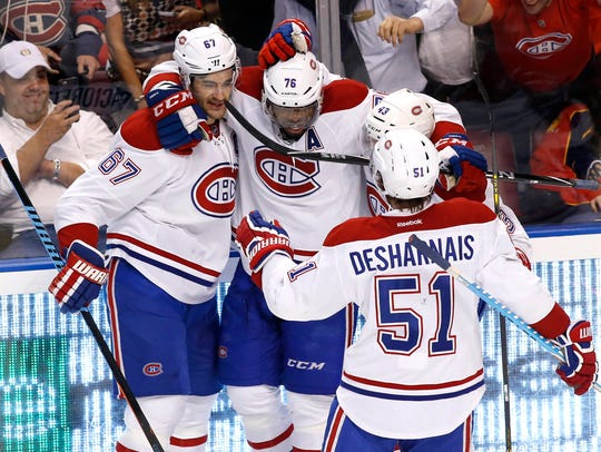 P.K. Subban celebrates with Canadiens teammates during