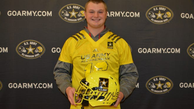 Bay Port senior Cole Van Lanen poses with the helmet he will wear at the 2016 U.S. Army All-American bowl in January.