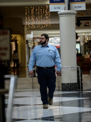 Dean Houshower, a public safety officer at the Lebanon Valley Mall, patrols the mall on Thursday, December 3, 2015.