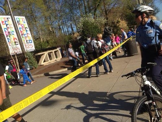 Police are looking for two men in connection with the shooting across from the entrance of the National Zoo