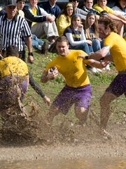 Members of the now-banished Sigma Alpha Epsilon fraternity play against another University of Michigan Greek team in this 2008 photo taken at the Mud Bowl.