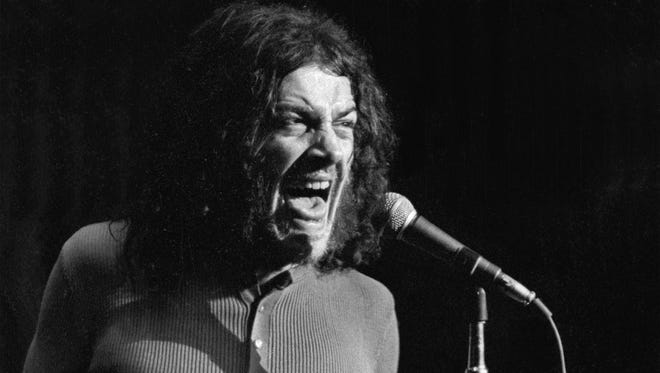 """In this June 1970 photo released by Linda Wolf, British singer Joe Cocker performs during the Joe Cocker - Mad Dogs & Englishmen tour and traveling party. Cocker, the raspy-voiced British singer known for his frenzied cover of """"With a Little Help From My Friends,"""" and the teary ballad """"You Are So Beautiful,"""" died of lung cancer on, Monday, Dec. 22, 2014 in Colorado. He was 70."""