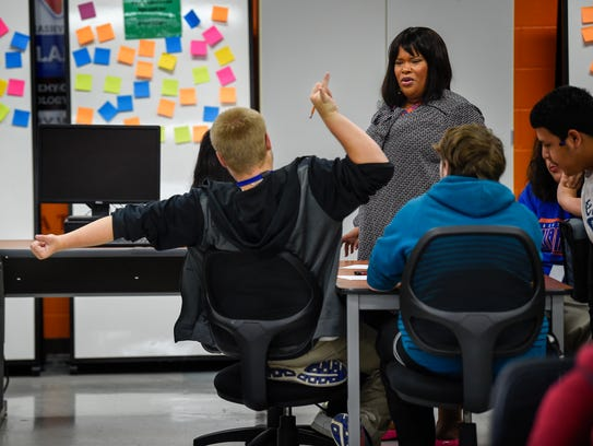 Teacher Ashley Ross reacts to some of her students