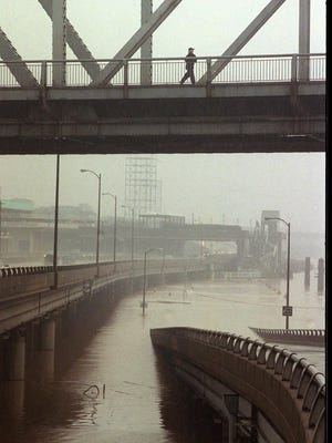 The Third St. ramp from I-64 was closed and much of the staircase of the waterfront was under flood water.