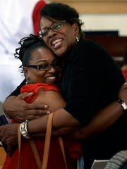 Dr. Iris Gordon-Harris, right, hugs her friend Iris Beech after the morning worship service at Shorter Chapel AME Church during its 150th anniversary celebration Sunday, August 12, 2018, in Franklin, Tenn.