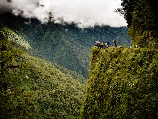 "Join us for a white-knuckle ride on 12 of the world's scariest roads that traverse adventurous destinations from Alaska to Afghanistan. By the time you're done, perhaps you'll consider flying. The Death Road, Bolivia: Bolivia's Old Yungas Road is a winding, 40-mile-long stretch that links the high Andean capital city of La Paz to Coroico, 11,500 feet below in the Amazon basin. Even though new construction bypasses one of the most treacherous sections and its steep hills have become a tourist attraction for adventurous mountain bikers, the so-called ""Death Road"" still kills more than 100 people each year."