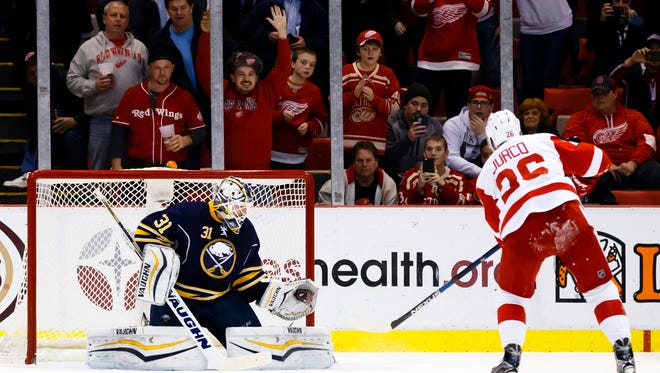 Dec 14, 2015; Detroit, MI, USA; Buffalo Sabres goalie Chad Johnson (31) makes the save on a penalty shot by Detroit Red Wings right wing Tomas Jurco (26) in the second period at Joe Louis Arena.