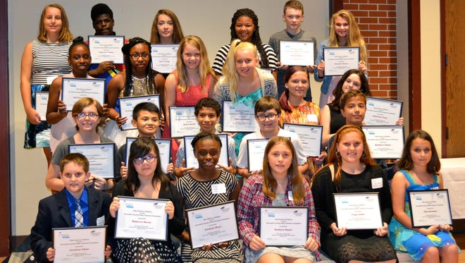 Students selected for the Take Stock in Children scholarship pose at the kick-off dinner.