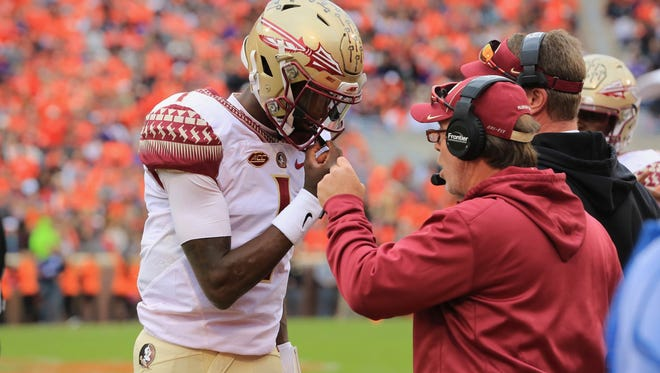 Jimbo Fisher talks with freshman quarter back James Blackman during the 1st quarter in Death Valley.