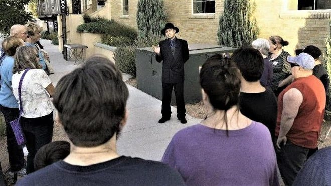 "As ""Pretty Boy"" Floyd, Johnny Lucero visits with Historical Ghost Walk patrons during the 2018 event."