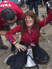 Jennifer Sterling, one of the organizers of the pro-Donald Trump rally reacts after getting hit with pepper spray in Huntington Beach, Calif., on Saturday, March 25, 2017.