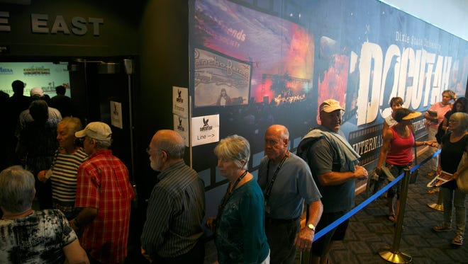 "DOCUTAH filmgoers make their way through the line and into a theater for a screening of a film called ""A Place to Stand"" at the Dolores DorŽ Eccles Theater Tuesday, Sep. 8, 2015 on the first day of the DOCUTAH International Documentary Film Festival on the campus of Dixie State University."