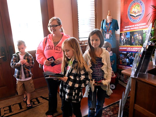 Carrie Young, who was visiting from Layton, Utah, stopped by the Abilene Convention and Visitors Bureau on April 5  with her children, her father Mike Conners and other family members.