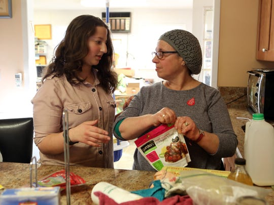 Gila Grossman, 16, tells her mother, Eileen Grossman, a story from school during dinner preparations at home in New Hempstead March 22, 2018.