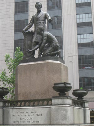 Boston Mayor Marty Walsh is considering the fate of a public statue depicting President Abraham Lincoln standing before a freed black man after a petition called for its removal.