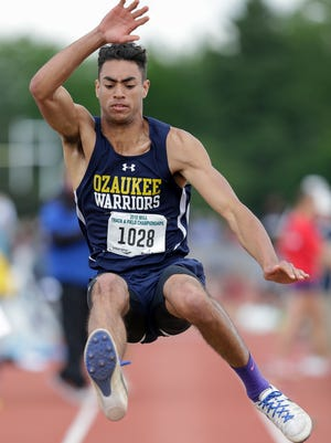 Ozaukee's Gavin Dorrler jumps in the Division 3 long jump finals during the WIAA state track and field meet at Veterans Memorial Stadium on Saturday in La Crosse.