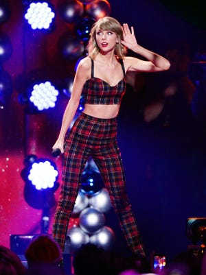 """Taylor Swift performs at Z100 Jingle Ball Dec. 12 in New York. Her album """"1989"""" is back at No. 1."""