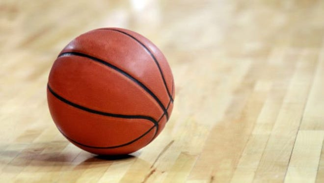 Tuesday night's high school boys basketball game between Holt and Everett was delayed for about an hour before being completed without fans in the gym, officials confirmed Wednesday.