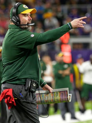 Green Bay Packers head coach Mike McCarthy talks to officials after center JC Tretter was called for unsportsmanlike conduct during the fourth quarter.