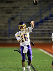 Wylie quarterback Sam King warms up on the sideline